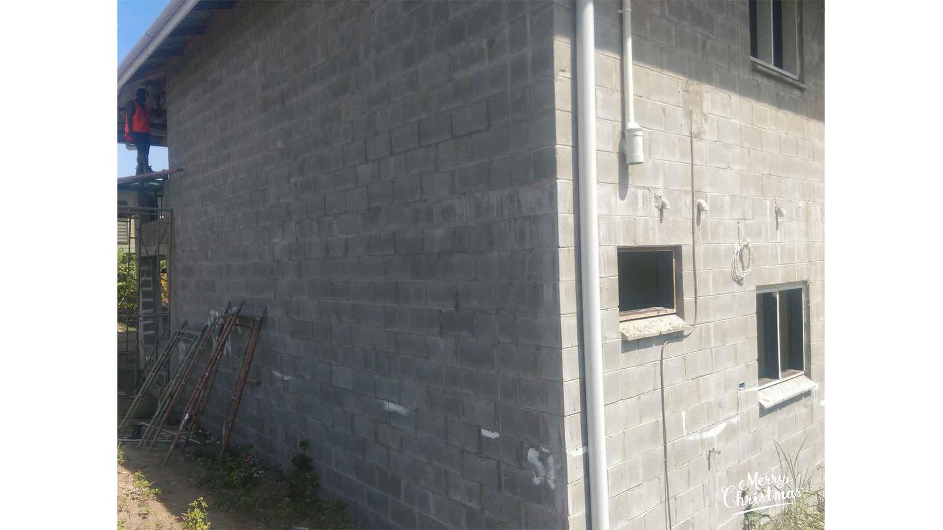 building under construction by Wapco Builders