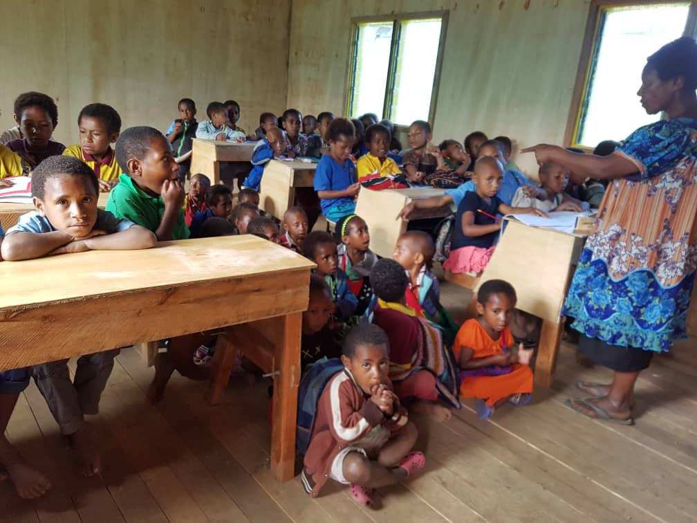 Students inside a newly built classroom by Wapco Builders